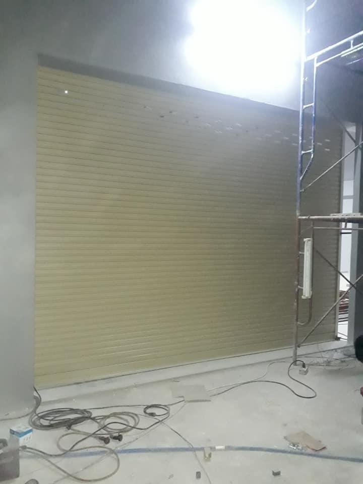 ซ่อมประตูม้วน บางกระดี่24 งานติดตั้งใหม่ระบบมอเตอร์ พร้อมติดตั้งสวิตสัมผัสหยุด กันหนีบ