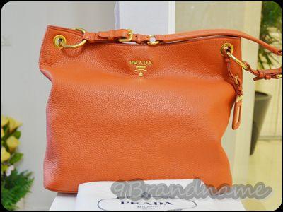 Prada Vitello Daino Tote orange กระเป๋าสะพาย shopping tote ใบใหญ่สีส้ม หนังแท้ทั้งใใบ สภาพดี สุดคุ้มค่ะ