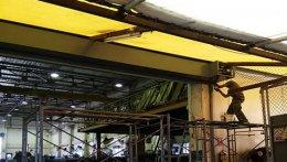 ซ่อมประตูม้วน นิคมโรจนะ1 งานติดตั้งใหม่รื้อบานแบ่งออกติดบานเต็มเป็นระบบมอเตอร์ไฟฟ้า