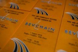 พิมพ์อะคริลิคแผ่นเชิญร่วมงาน พิมพ์ลายลงบนแผ่นอะคริลิคสีส้มใส ลาย BEVCHAIN