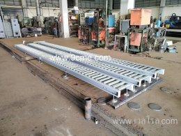 ลูกกลิ้งลำเลียงแบบใช้แรงโน้มถ่วง (Gravity roller conveyor)