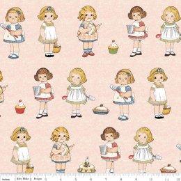 ผ้า cotton อเมริกา น้องแก้มป่อง พื้นชมพู ขนาด 20 x 110 cm.(ตุ๊กตา 2 แถว = 32 ตัว)