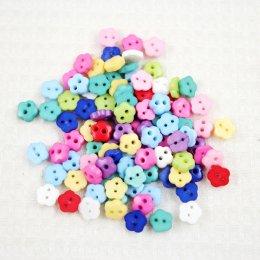 กระดุมดอกไม้คละสี ขนาด 0.6 mm. 40 เม็ด/แพ็ค