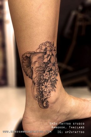 Elephant with flowers Tattoo