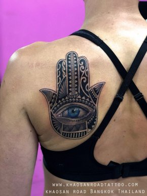 Hamsa tattoo symbolizes the Hand of God. Hand of Fatima. It brings it's owner happiness, luck, health, and good fortune.