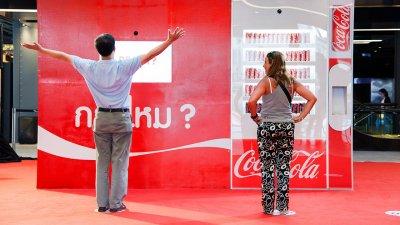 Coke Sleek | Surprise vending machine
