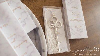 White tassel key opener