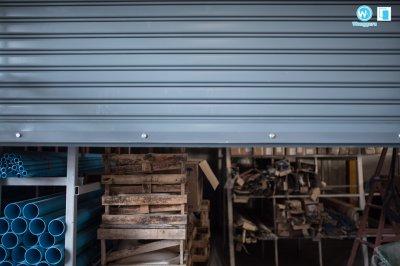 งานติดตั้งประตูม้วนมอเตอร์ไฟฟ้า ร้านขายวัสดุก่อสร้าง
