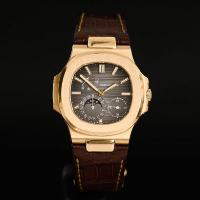 Patek Philippe Nautilus 5712R Rose Gold Power Resrve & Moonphase Full box & card