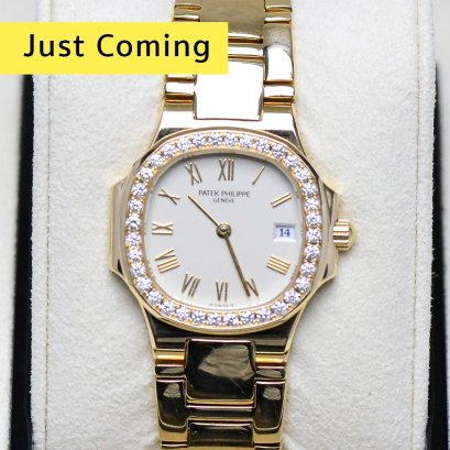 Patek Philippe Nautilus Ladys diamond  yellow gold watch