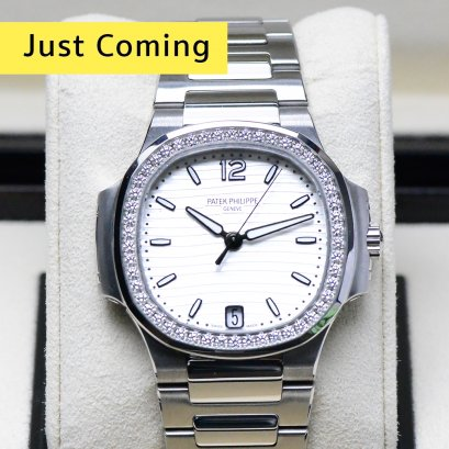 Patek 7018/1A Nautilus Steel with Diamond Bezel Silver Dial Automatic size 35m Box and Paper Y2015 P1. MB