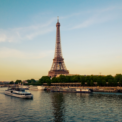 Effel Tower with boats in evening Paris, France